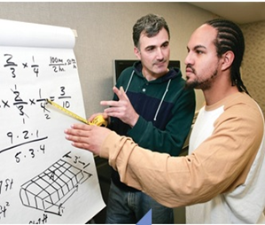 A manufacturing employee receives a lesson in math and measurement from a Camden County College instructor.