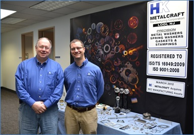 Bob MacPhee, left, and HK Metalcraft President Josh Hopp, stand next to the company's product-display table at the Lodi, NJ plant.