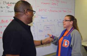 Cumberland County College instructor Gerald Bose reviews a math problem with student Allisen Cox-Boldley.