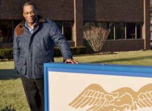 Freedom Mortgage HR manager Andrew Boney stands outside the company's Moorestown office at 301 Harper Drive.